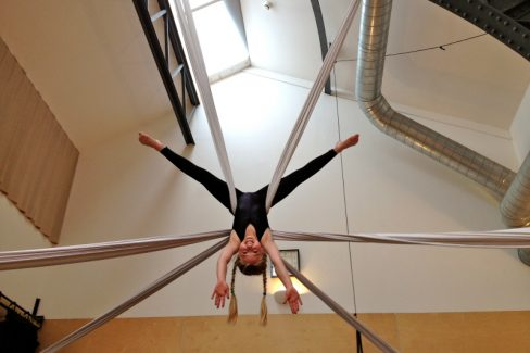 girl suspended in 2 silks, upside down star shape